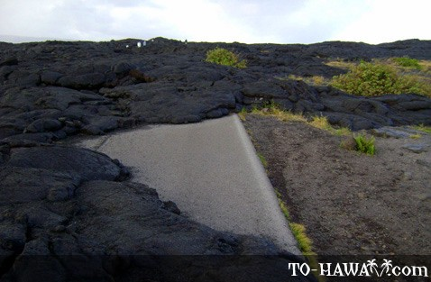 Road swallowed up by lava flow