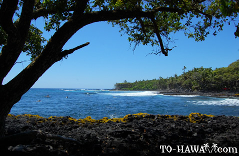 Black lava rocks and blue ocean