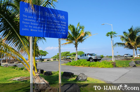 Beach park sign and parking lot