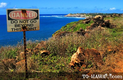 Danger sign on rocky shore on Kauai