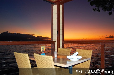 Oceanfront dining at sunset on Maui