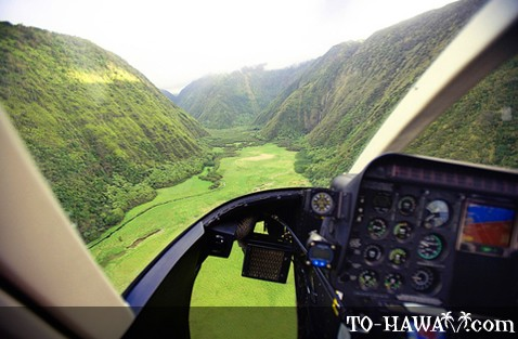 Helicopter flight above lush valley
