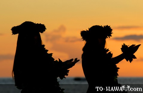 Two hula dancers at sunset