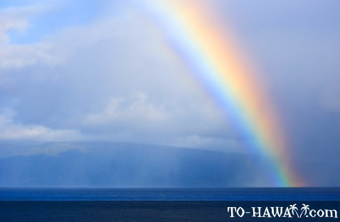 Rainbow in front of Maui's coastline