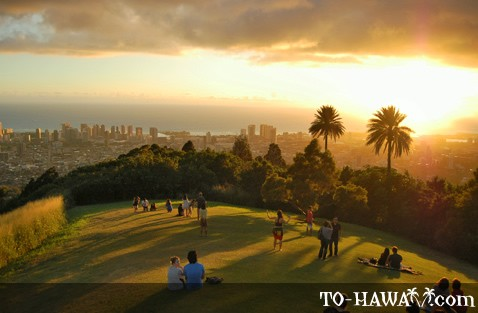 People enjoying the sunset over Honolulu