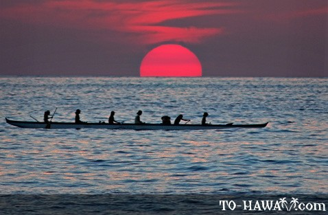 Hawaiian canoe coming home at sunset