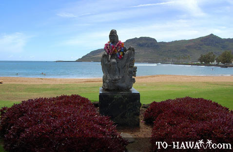 Statue decorated with flower leis