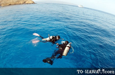 Scuba diving near the volcanic island