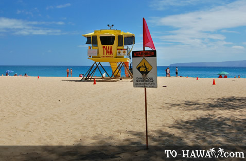 Warning sign in front of the lifeguard tower