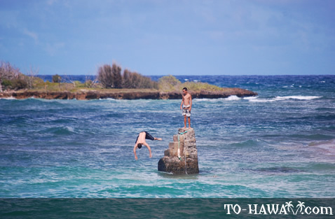 Kids jumping from a rock