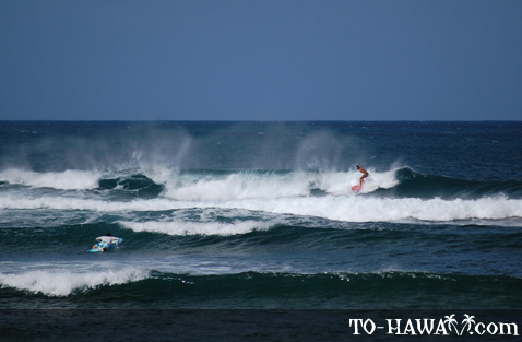 Surfing at Pua'ena Point