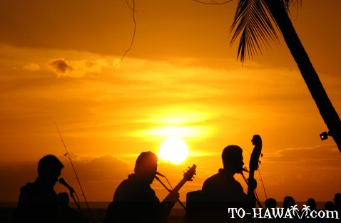 Musicians' silhouettes at sunset
